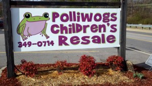 polliwogs kids clothes store sign